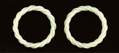 A PAIR OF WHITE JADE ROPE-TWIS