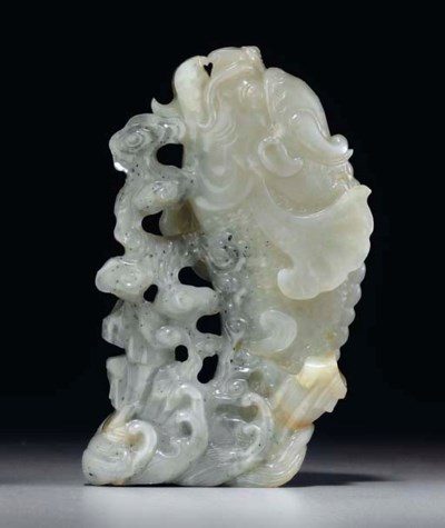 A WHITE AND GREY JADE CARP-FOR