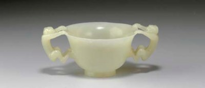 A SMALL WHITE JADE TWO-HANDLED
