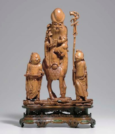 AN UNUSUAL CARVED BAMBOO FIGUR