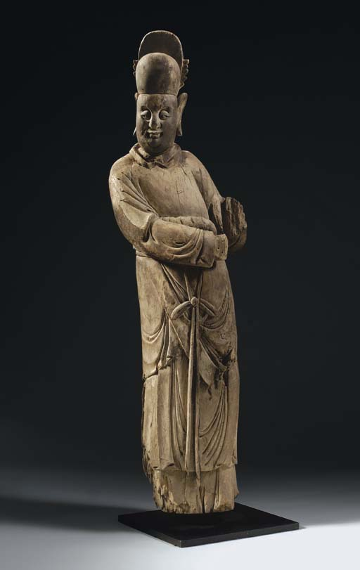 A RARE LARGE WOOD FIGURE OF AN