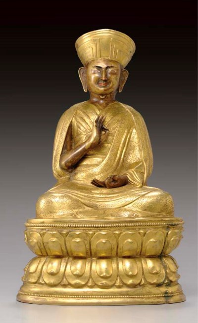 A gilt bronze figure of a Lama