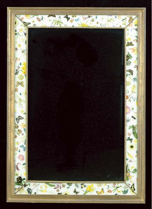 A RECTANGULAR WALL MIRROR WITH