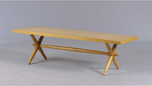 A LIGHT WALNUT COFFEE TABLE,