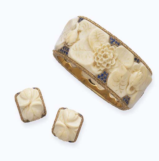 **A SET OF IVORY AND SAPPHIRE