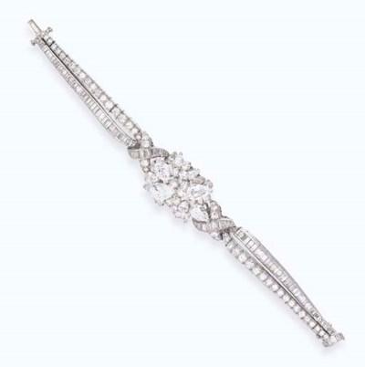 A DIAMOND BRACELET, BY OSCAR H