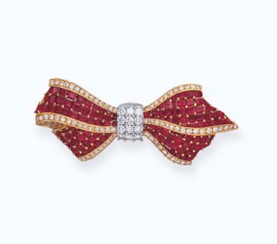 A RUBY AND DIAMOND BOW BROOCH,