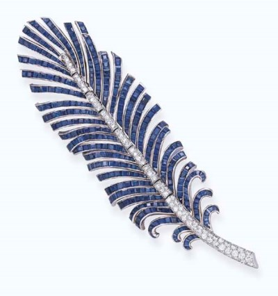 A SAPPHIRE AND DIAMOND FEATHER