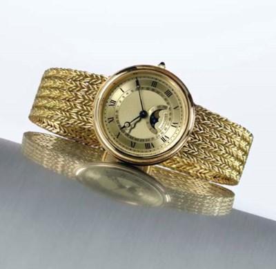 BREGUET. AN 18K GOLD AUTOMATIC