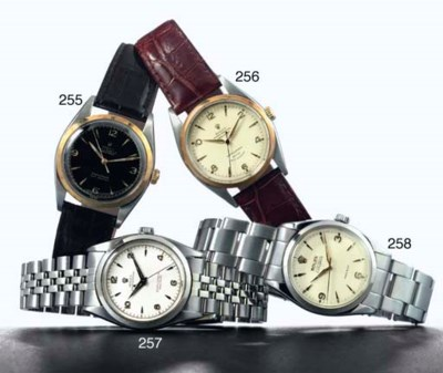 ROLEX.  A STAINLESS STEEL AND