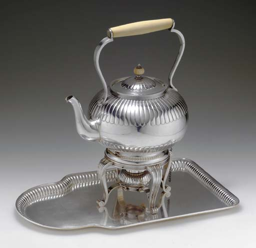 A SILVER TEAPOT AND TRAY