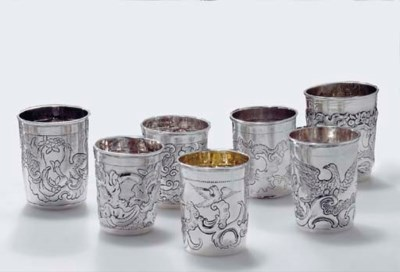 A GROUP OF SEVEN SILVER BEAKER