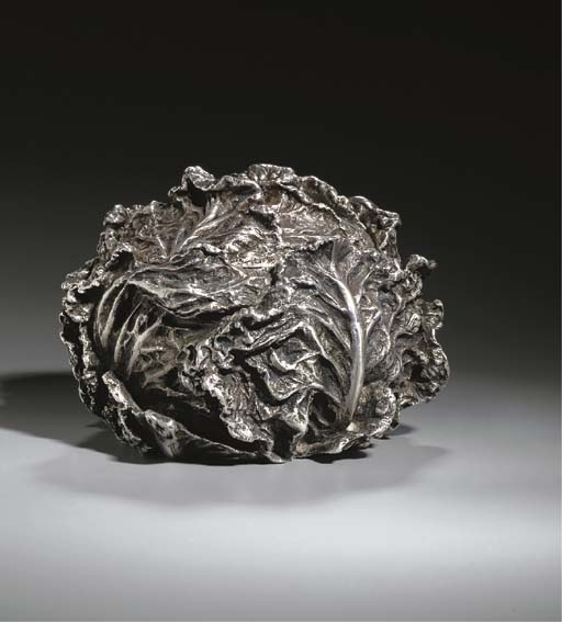 A COVERED SILVER BOWL
