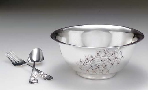 A SILVER BOWL WITH SERVING SPO