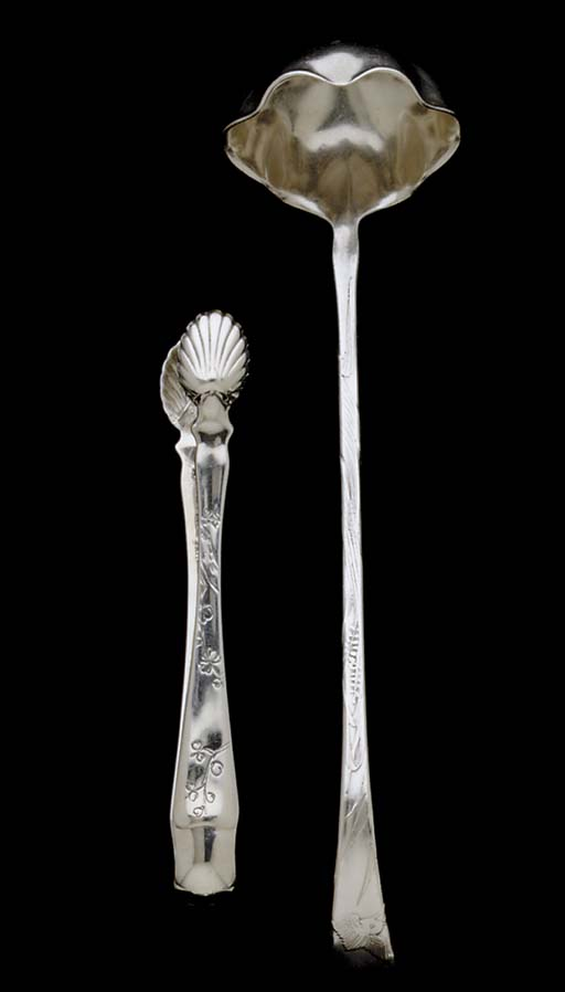 A PAIR OF SILVER SUGAR TONGS A
