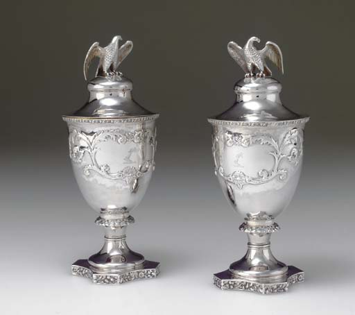 A PAIR OF SILVER COVERED VASES