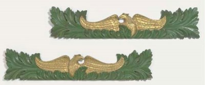 A PAIR OF CARVED GILT AND POLY