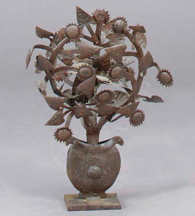 A PATINATED METAL FLORAL FORM