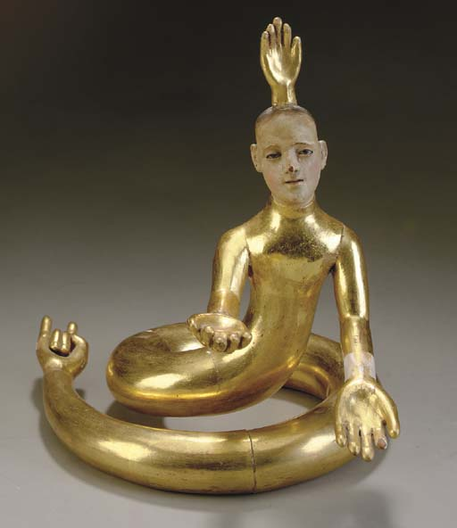 A POLYCHROME PAINTED AND PARCEL GILT CARVED SERPENT MAN WITH MANY HANDS,