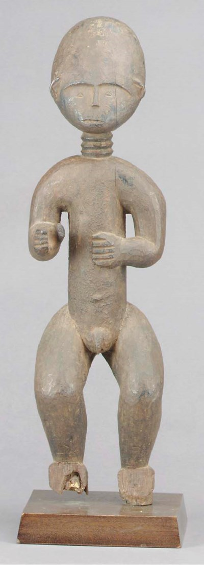 AN AKAN MALE FIGURE,
