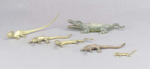 A GROUP OF FIVE BRASS LIZARDS