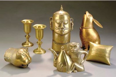 A GROUP OF SEVEN BRASS DECORAT