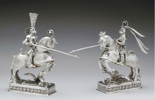 A PAIR OF GERMAN SILVER AND IVORY FIGURES OF KNIGHTS ON HORSEBACK**,