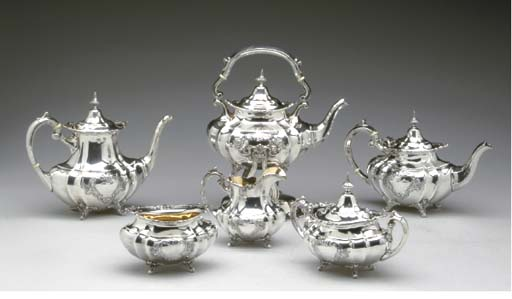 AN AMERICAN SILVER SIX-PIECE TEA AND COFFEE SERVICE**,