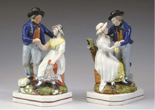 A PAIR OF STAFFORDSHIRE FIGURAL GROUPS OF COURTING COUPLES,