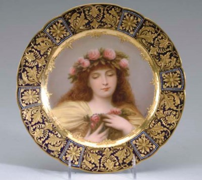A VIENNA STYLE GILT AND PAINTE