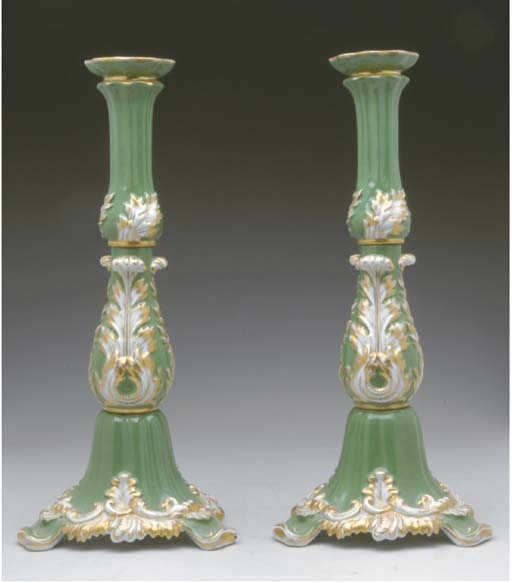 A PAIR OF CONTINENTAL ROCOCO STYLE PORCELAIN CANDLE HOLDERS,