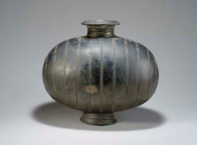 A VERY LARGE GREY POTTERY 'COC