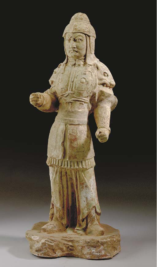 A CHINESE STRAW-GLAZED BUFF POTTERY FIGURE OF A STANDING SOLDIER,