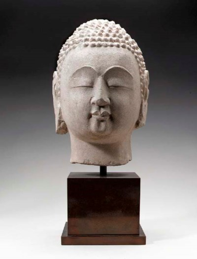 A CHINESE SANDSTONE HEAD OF BU