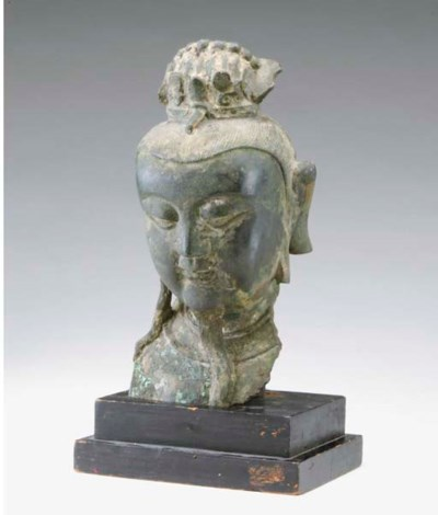 A CHINESE BRONZE HEAD OF AN OF