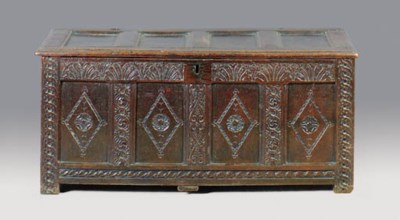 A JACOBEAN CARVED OAK COFFER,