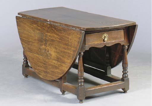A GEORGE I OAK CIRCULAR GATELEG TABLE,