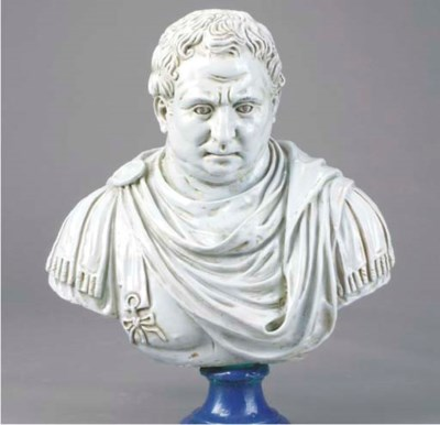 A GLAZED POTTERY BUST OF AN EM