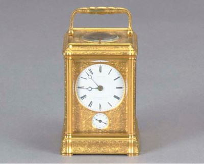 A FRENCH GILT-BRASS CARRIAGE C