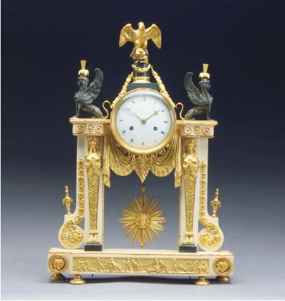 A LOUIS XVI STYLE PATINATED AN