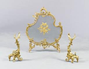 A PAIR OF LOUIS XV STYLE GILT BRONZE CHENETS AND A FIRESCREEN,