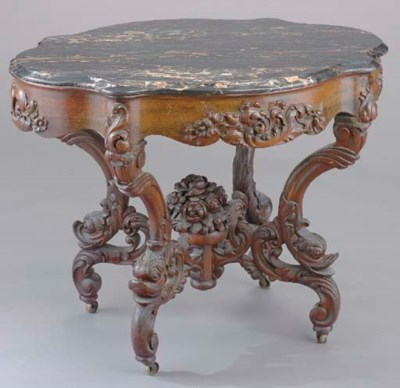 AN AMERICAN CARVED ROSEWOOD MA