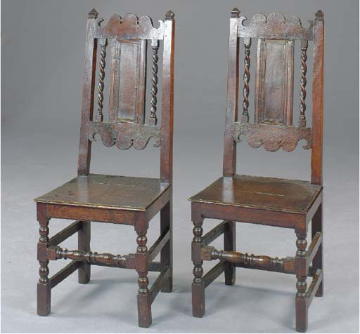 A PAIR OF JACOBEAN STYLE OAK SIDE CHAIRS,