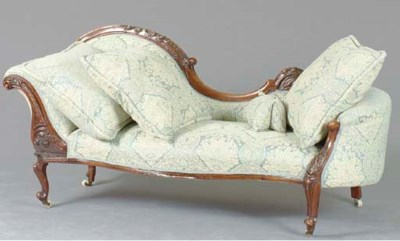A VICTORIAN CARVED MAHOGANY RE