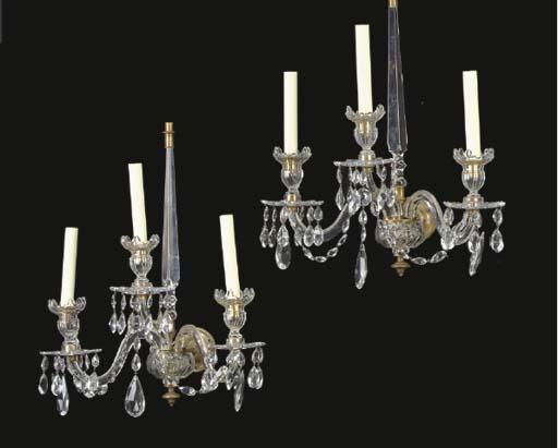 A SET OF FOUR ANGLO-IRISH CUT-GLASS THREE-LIGHT WALL LIGHTS,