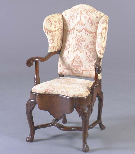 A DUTCH ROCOCO STYLE WALNUT COMMODE WING ARMCHAIR,