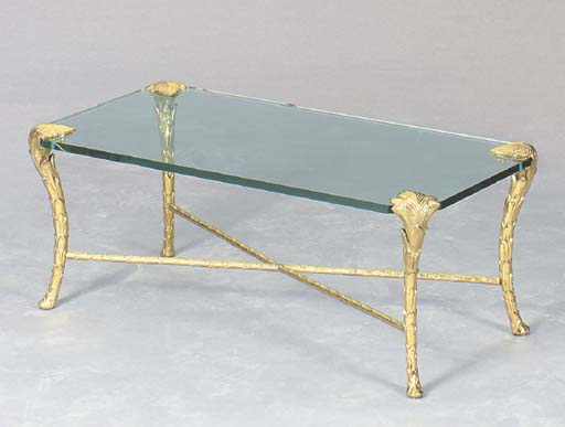 A CONTEMPORARY GILT-BRONZE AND GLASS LOW TABLE,