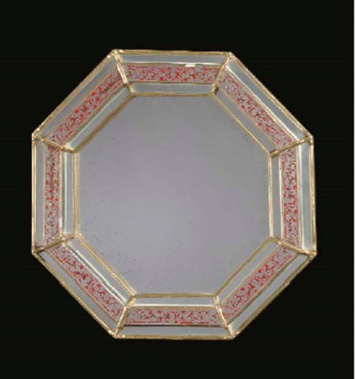 AN OCTAGONAL GILT AND PAINT DE