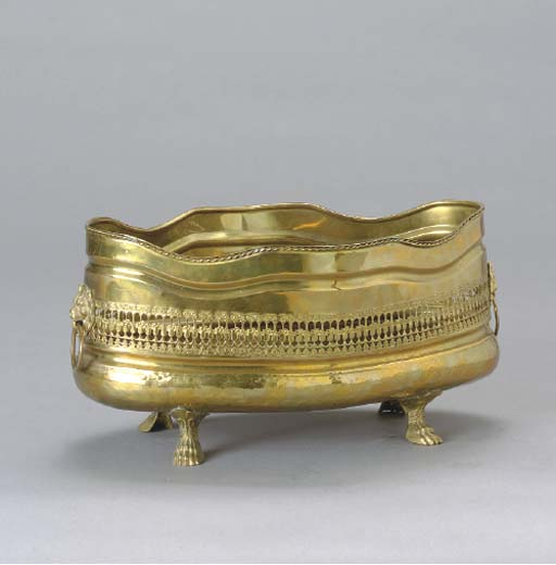 A PIERCED BRASS LOW BASKET,
