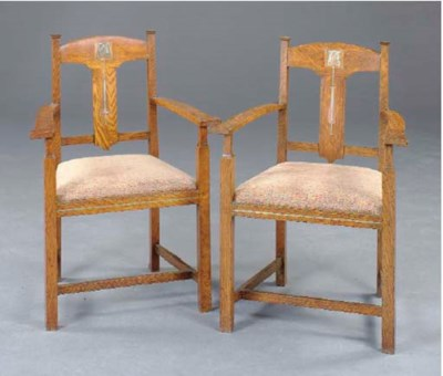 A PAIR OF ARTS AND CRAFTS OAK,
